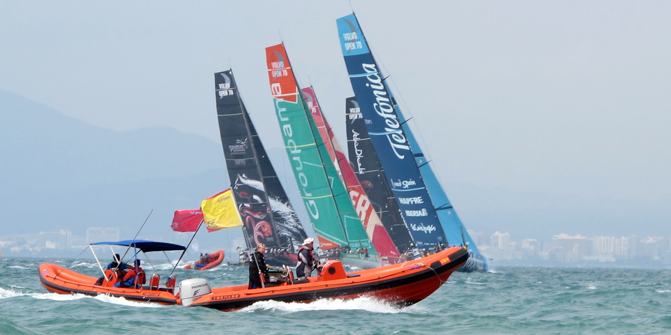 Tornado 6.4m high performance in orange sailing at Volvo Ocean Race